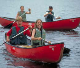 Kids participate in outdoor activities such as canoeing through YMCA Adventure Guides.