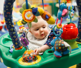 A baby plays in a bouncer in YMCA Child Watch a free babysitting service for YMCA Family memberships.