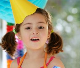 A girl celebrates her birthday with a swimming birthday party at the YMCA pool