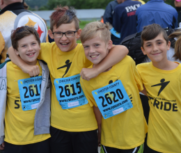 group of boys excited about STRIDE 5K